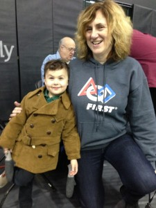 The Proceeds of (Serious) Play: My Grandson Grey hams it up with Patricia Daly, Regional Director, NYC, for FIRST, the STEM-Education fostering non-profit, at FIRST LEGO League Brooklyn Qualifier held at NYU-Poly in MetroTech Center, Saturday, 11 Jan 2014