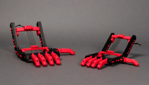 """A Pair of Robohands, A Seminal Example of DIY/DIT 3DP-Driven """"Good-Enough Tech"""" (GET). Thanks to MakerBot for the photo (these Robohands were made on a MakerBot printer)."""