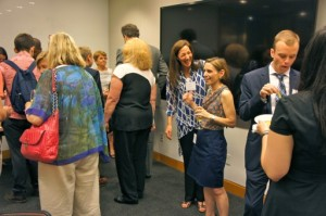 "Bunny Ellerin (3rd from right, in dark blue skirt), President & Co-Founder of NYCHBL, greets constituents and guests at the reception before NYCHBL's panel ""The 3D Printing Revolution Meets Healthcare"" at Cooley LLP, New York City, 17 June 14."
