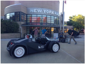 "The Local Motors ""Strati"" 3D-Printed, open-source, crowd-designed-winner car parked in front of MakerCon New York, NYSCI---""built"" in 40 hours of realtime printing on a public exhibit-stand at the Intl Manufacturing Tech Show 2014 (in Chicago Sept 8 to 13, McCormick Place). Photo compliments J. E. Earle/Eventifier."