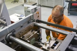 Worrell's injection molding technician removes a polycarbonate part from a 3D printed injection mold.