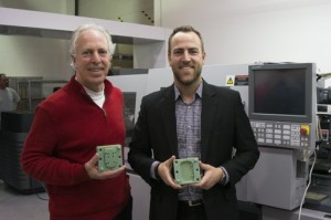 "Bob Worrell (left), Founder & Chairman and Kai Worrell, CEO, Worrell Design, displaying ""3D IM"" Injection Molding Fixtures on Worrell production floor."